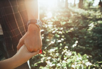 Couple Holding Hands in the Garden free stock photo